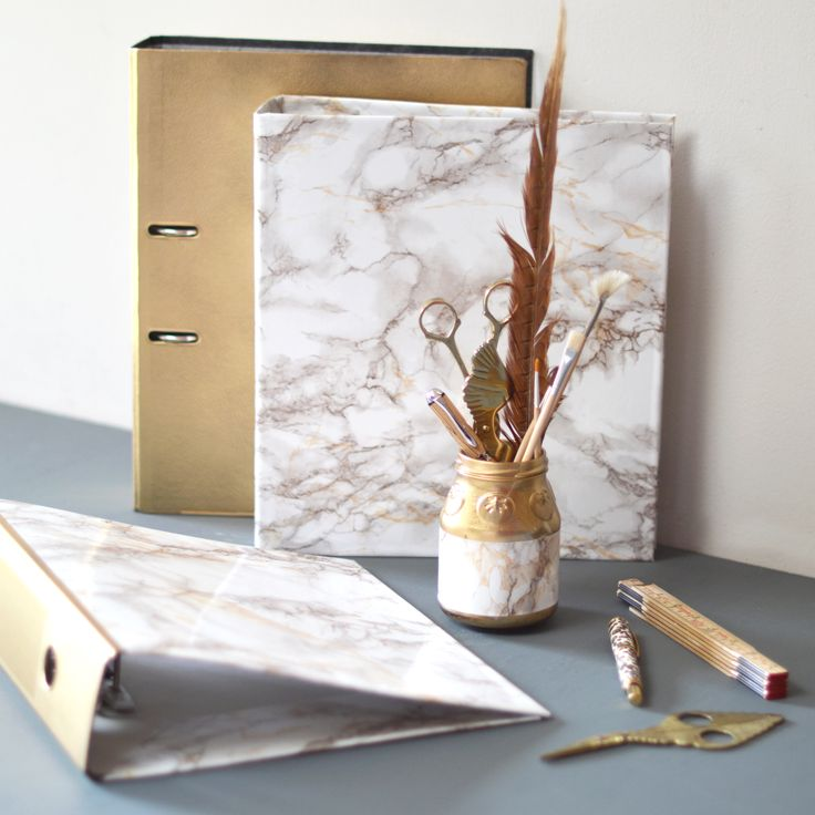 Marble and gold is the hit of the season, so here's our simple instructions on how to cover a lever arch file, to create your very own glam office décor.