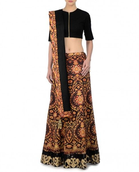 Black lengha with Persian prints all over. Metallic golden accents and sequins work adorn the hem. This set also matching black elbow sleeves blouse with round neckline and zipper front. Wash Care: Dry clean onlyMatching dupatta includedClosure: Zip at side