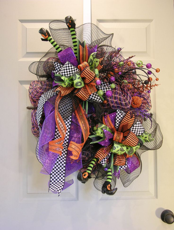 It's all about bows and legs with this Halloween wreath. Two large gathering bows sit on top of plaid deco mesh and topped with a six patterned Terri Bow in Halloween prints and colors. Cute little wi