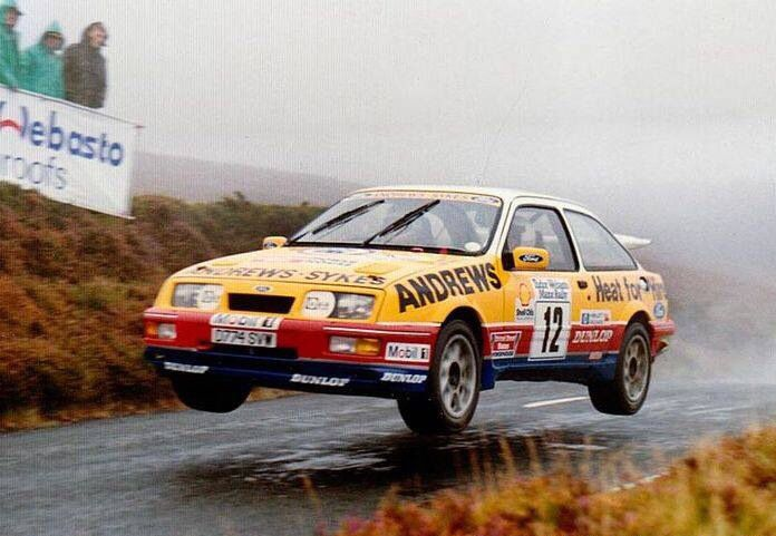 Rusell Brooks in a Ford Sierra XR4 ; probably on a Manx Rally .