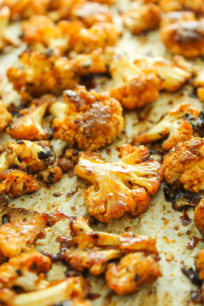 This recipe for oven roasted, sweet and spicy cauliflower is a crowd-pleaser. Toss it on a sheet pan and it's ready in no time! Vegan and gluten free.