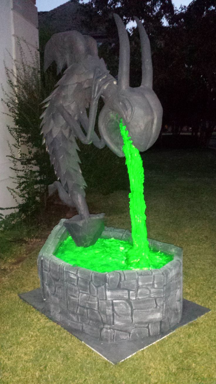 Nightmare Before Christmas fountain. This was my first ever attempt at making a large halloween prop. It took a lot of time, especially since I really had no idea what I was doing. It was a learn as you go kind of thing. I used PVC pipe, chicken wire, expanding foam, styrofoam, monster mud, paper mâché, paint ...... So far it has been a huge hit.