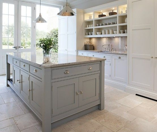 coloured island, white units - also love the shelves above sink