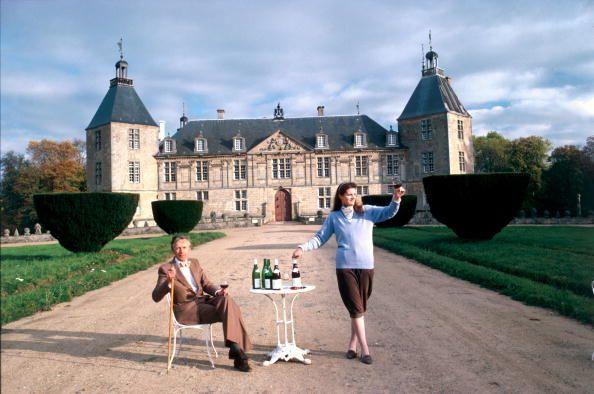 Title:Chateau De Sully   Caption:November 1986: Phillipe, Duc De Magenta et Marquis De MacMahon outside Chateau Sully in Autun with his fiancee Amelie Drummond.       Artist:Slim Aarons  Date:1986