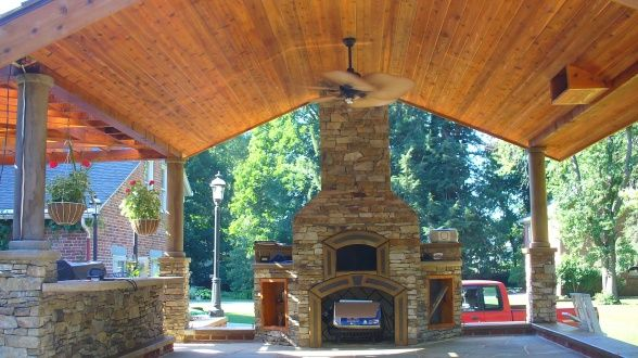 Fireplace with pizza oven above, Wood burning fireplace that heats oven to 600 degrees . Pizza takes 5-8 minutes to cook., Wood Burning fireplace with gas starter. Pizza oven above .I designed and built with dual purpose. Fast starting and easy cleaning. Custom doors were added, Patios & Decks Design