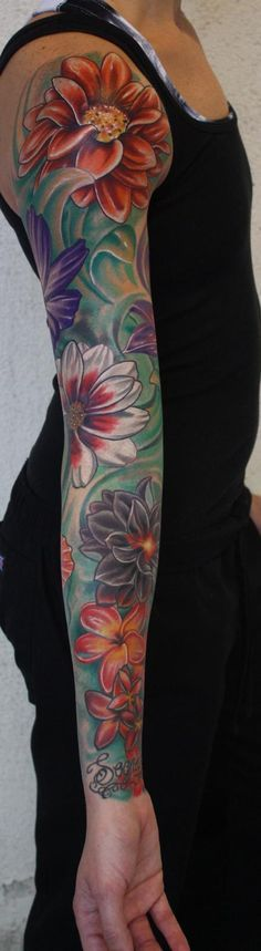 Like the idea of blue behind flowers in my tattoo to represent the ocean