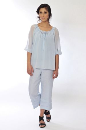 Spring has sprung with Genoa, a charming silk georgette draw cord blouse. Wear it over one of The Cupboard's popular matching singlets and team the two with the impertinent Castaway pleat hem linen pant.