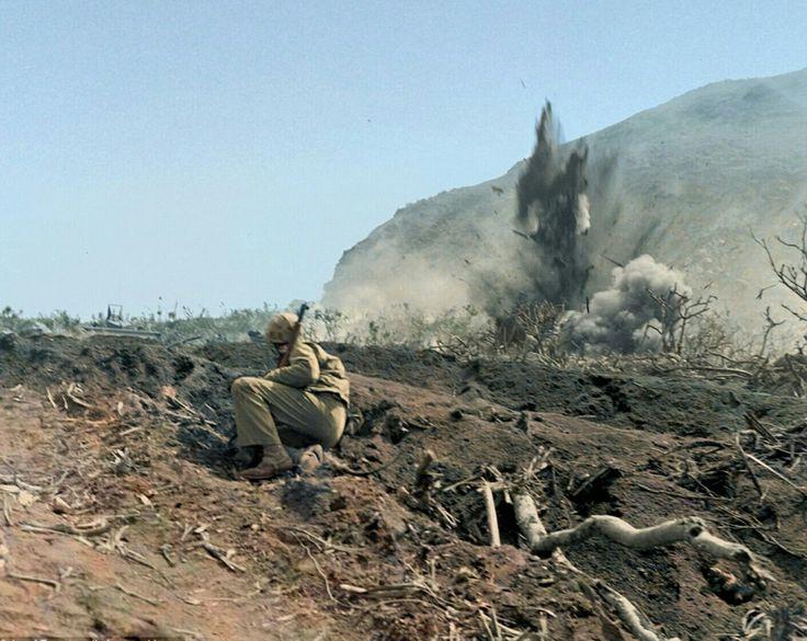 Iwo jima march 1945 marine  observe explosion