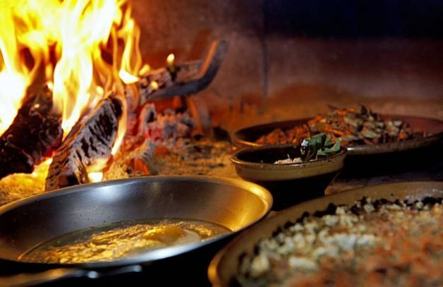 Several dishes cooking in the wood oven at Camino restaurant in Oakland, Calif., on Wednesday, October 7, 2009. Chef/owner Russell Moore is doing the cooking. Photo: Carlos Avila Gonzalez, The Chronicle