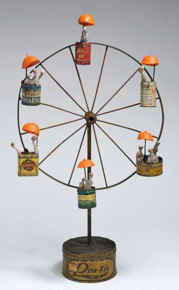 Gerard Cambon...love the addition of the orange umbrellas. So clever