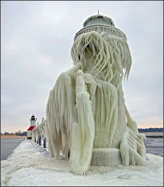 The 30 foot tall outer light of the St. Joseph, Michigan Pier after a severe winter storm. Waves on Lake Michigan were said to be over 20 feet high, which pounded the lighthouse and covered it in ice several feet thick in places.