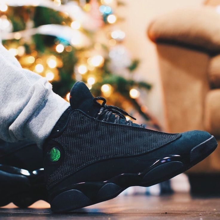 "A reflective ""Black Ca"" treatment for the Air Jordan 13."