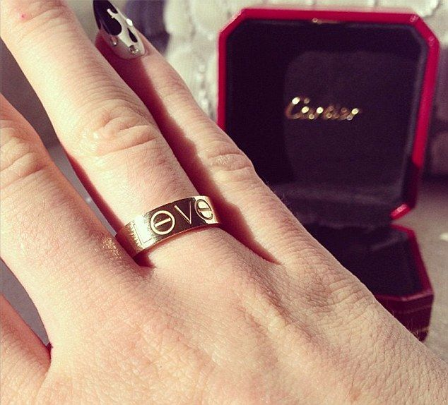 Love does cost a ring: Kylie Jenner showed off her newest Cartier Love ring on Saturday, which the fashion company says is the ultimate symb...