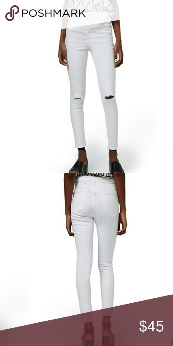 "Topshop High Waist Jeans Topshop High Waist Jeans  High-waisted stretch jeans in a bright white wash are ripped at the knees for a roughed-up, well-worn look. Ankle Length Size 2  27 1/2"" inseam; 10"" leg opening; 10"" front rise; 14 1/4"" back rise (size 28 x 32). Zip fly with button closure. Five-pocket style 91% cotton, 6% polyester, 3% elastane  Please check out my closet for other fabulous items  Reasonable offers welcome  Bundle and save   Bookmark my closet for new arrival and flash sale…"