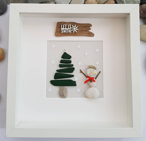 A beautiful and unique handmade beach pebble picture of snowman next to green painted slate Christmas tree with driftwood sign let it snow.  This picture is a lovely Christmas decoration and would make a perfect gift. The picture is made using pebbles, slate, paint, driftwood, wood, ribbon, shell and card. All materials are carefully placed and fixed with high strength glue onto grey card. I can include printed quotes or personalised messages onto picture. If you require personalisation…
