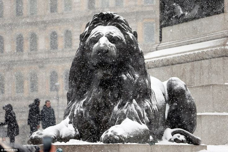 The lions of Trafalgar Square in London are covered in white powder as sub-zero temperatures continue to prevail in the capital and elsewhere