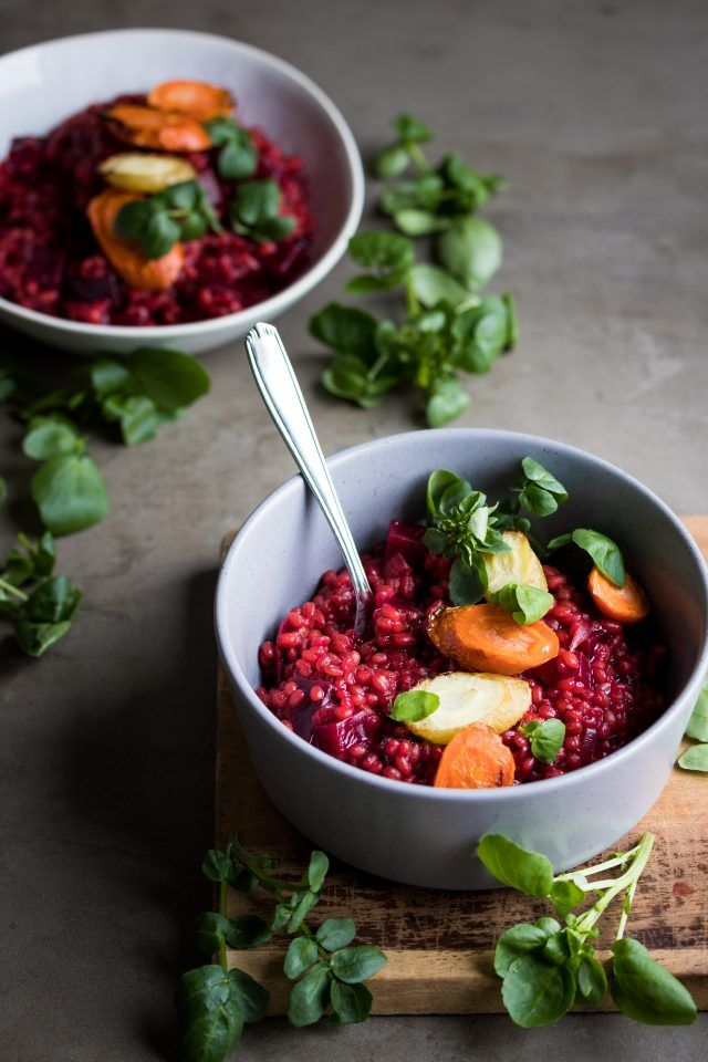 Barley risotto cooked with beetroot and roasted carrots