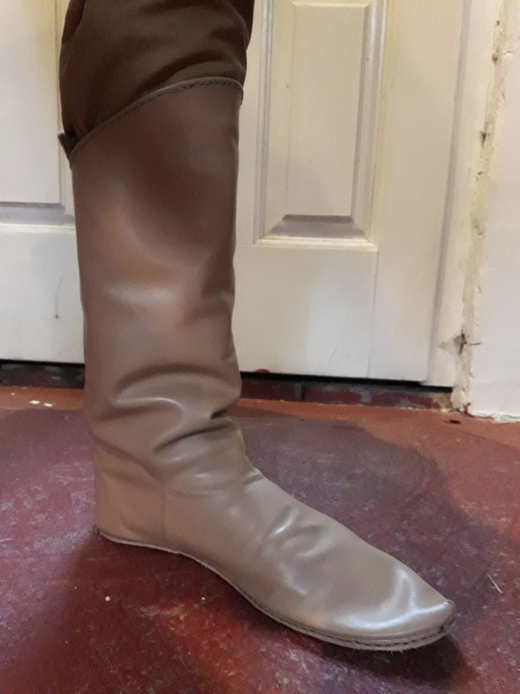 A picture of the medieval boots before adding the outside stitches.