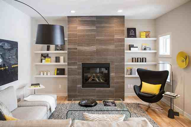 diy built in floating shelves on either side of the fireplace | brit.co