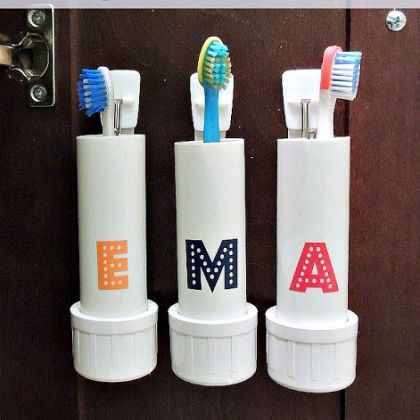 PVC Pipe Toothbrush Holders. Under the spice racks for holding hair products? One for each of the four of us!
