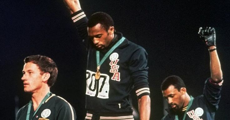 Sometimes photographs deceive. Take this one, for example. It represents John Carlos and Tommie Smith's rebellious gesture the day they won medals for the 200 meters at the 1968 Summer...