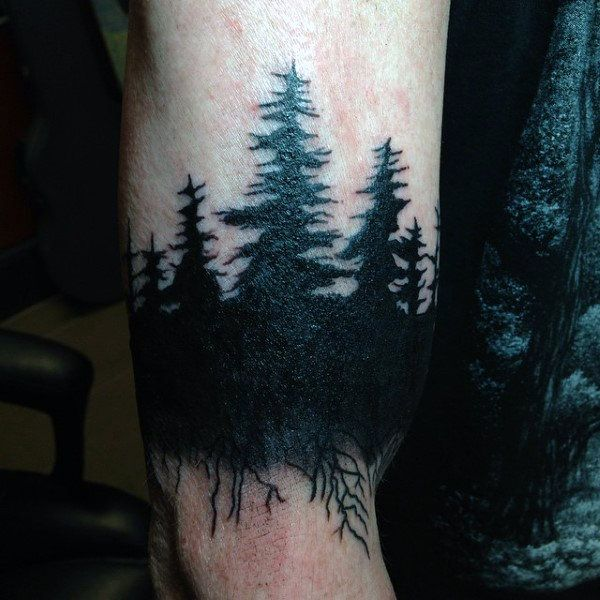 Tattoo Of Pine Tree Forest On Man