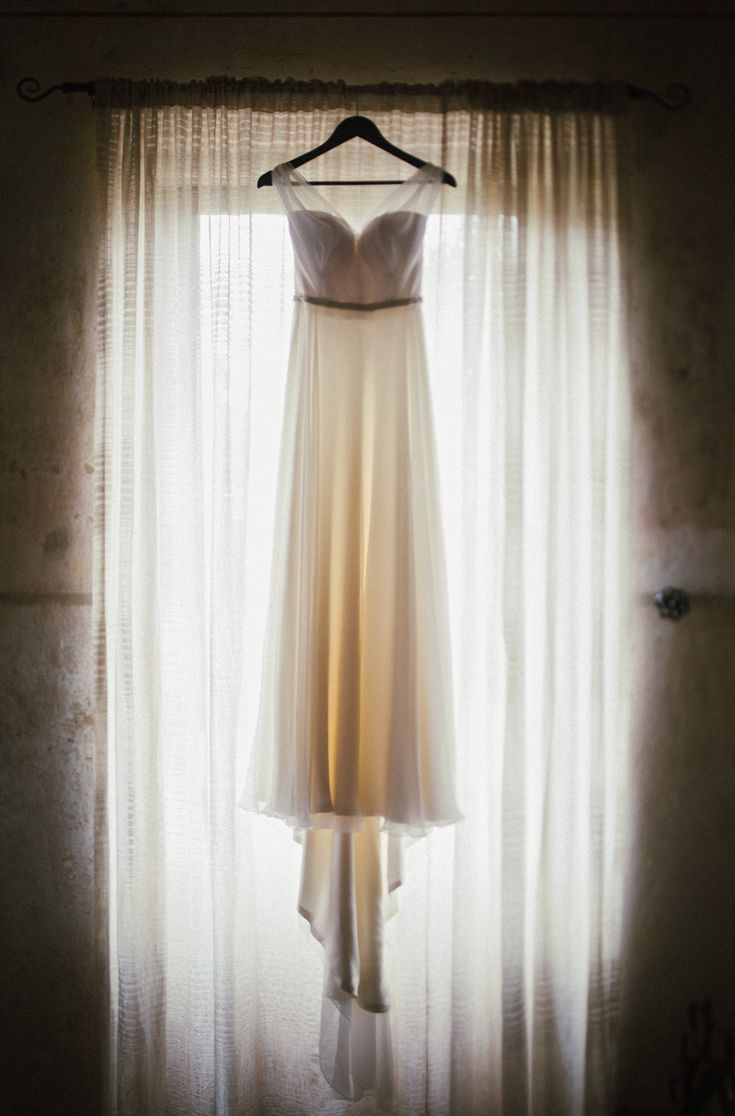 Laura's beautiful wedding dress. Hanging in Villa Parma in Daylesford. The BEST venue to get ready in for amazing preparation photographs.