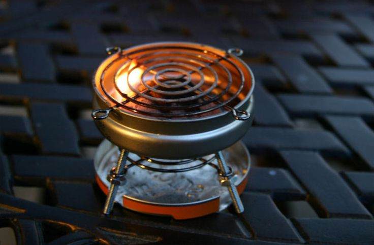 This tiny barbeque grill is made from a single Altoids Sours tin, two salvaged computer fan guards and a handful of nuts and screws, and it's big enough to handle a wiener or a hamburger patty!