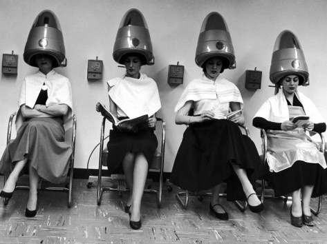 Women Sitting and Reading under Hairdryers at Rockefeller Center