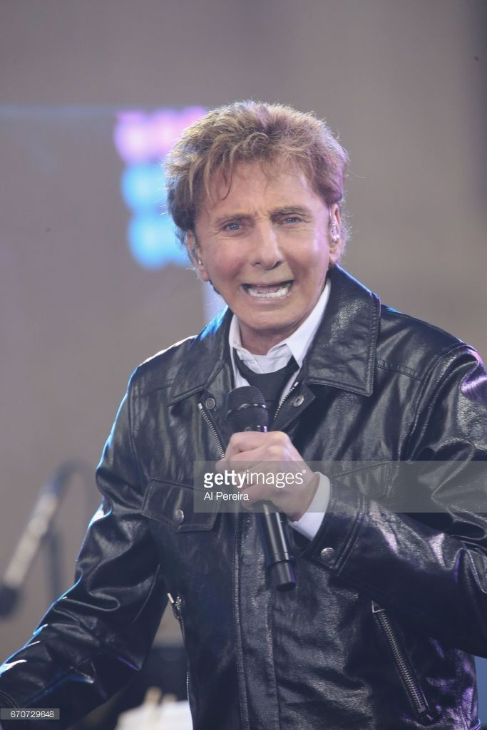 Barry Manilow performs in the rain on NBC's 'Today' Show at Rockefeller Plaza on April 20, 2017 in New York City.