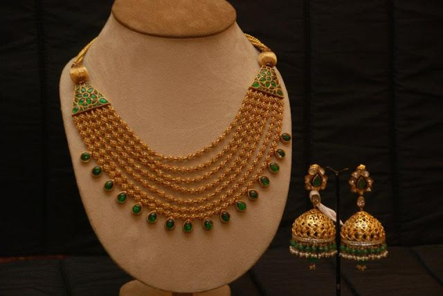 Old meets new in the 22k multi-strand necklace set with intricate emerald finishing bails.