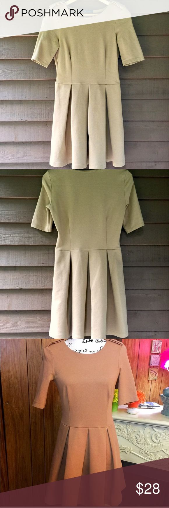 """Zara Woman Skater Dress Pre worn and besides for a tiny bit of pilling on the left sleeve as shown.. still in great condition ! Although short sleeved this is more of a fall/winter/springtime dress. It's a thicker material and has somewhat of a felt lining. It's a size small 23"""" in length. The bust is 34"""" and a 28"""" waist. The pleats are so very feminine. 👗 Zara Dresses"""
