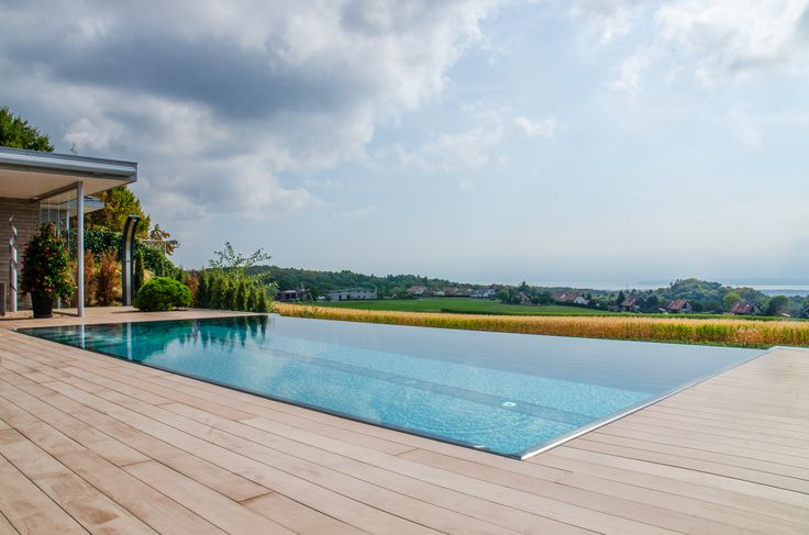 Stainless steel pool with overflow trough and lowered overflow trough (infinity pool)