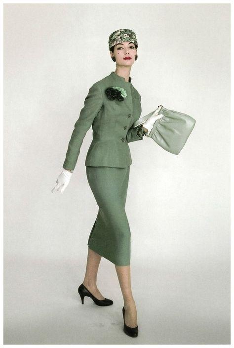 Simone d'Aillencourt in elegant linen suit and flower pot hat, Vogue UK, April 1956 Photo Eugène Vernier