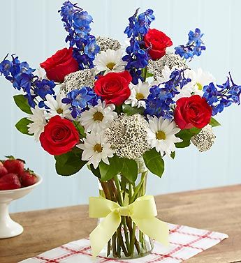 This beautiful red, white, and blue floral arrangement is the perfect 4th of July decoration to show off your American pride!