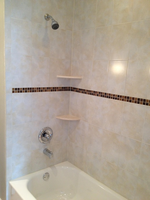 8x12 Ceramic Tile Tub Surround Installation With 1x1 Glass Tile Accent Band  A Marble Corner Shelves