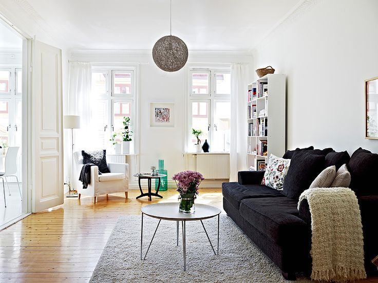 Livingroom Black Sofa White Walls And Furniture Add Accent Colors