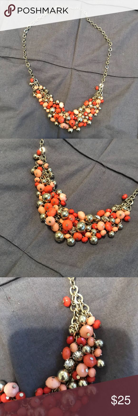 The Limited Coral statement necklace This necklace is beautiful! Different shades and sizes of coral color beads and small clear stones with gold chain. Chain length is adjustable. The Limited Jewelry Necklaces