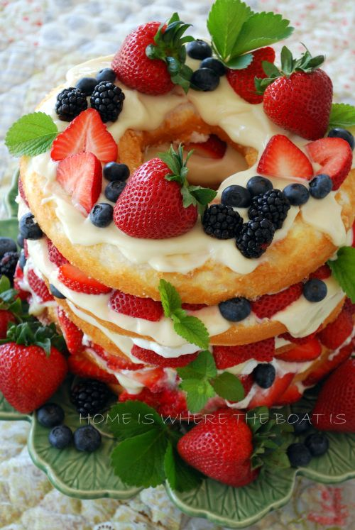 Store bought angel food cake layered with berries and a mixture of lemon curd and cream cheese.  Nice quick, luscious dessert!