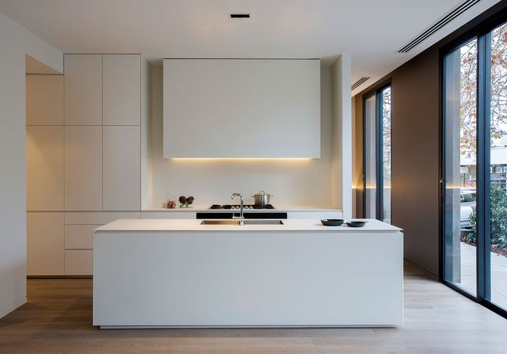 Clean lines. Love how you can't tell whether the cupboards are part of the kitchen or not.