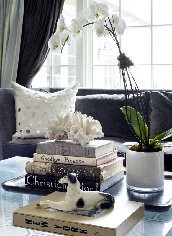 Coffee Table Styling, stack beautiful books on a tray, add 1 fun and interesting piece, 1 natural element and flowers