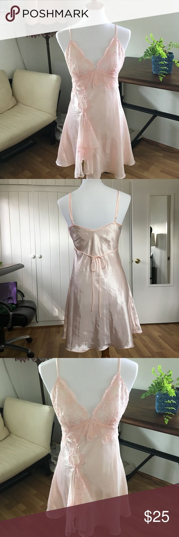 """⚡️1 DAY SALE⚡️Fleur De Lys Pretty Sexy Lingerie ✨Beautiful Fleur De Lys light pink embroidered night gown. This nightgown features a sexy lace top and a modest lace opening. This material is polyester so it will hold its shape. Delicate tie in the back makes a simple pretty bow. This has almost an hour glass shape to it. My favorite part is the lace leg opening.Chest 17"""" waist 14"""" hips 18"""". This item is in excellent lightly used condition.✨ Would make a sexy v short princess costume for…"""