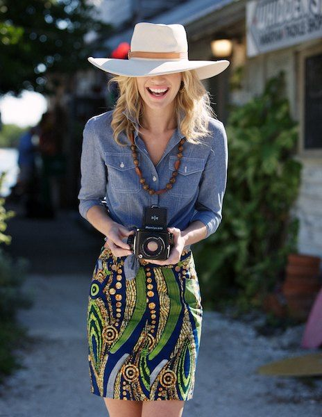 Love that skirt...shirt colour and the wooden beads... Oh...and the camera! Not so much the hat....