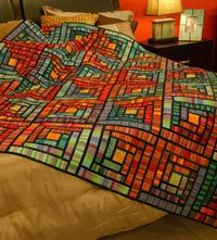 Stained Glass Cabins | Best Tradition with a Twist Quilts 2015 | Quilters Newsletter