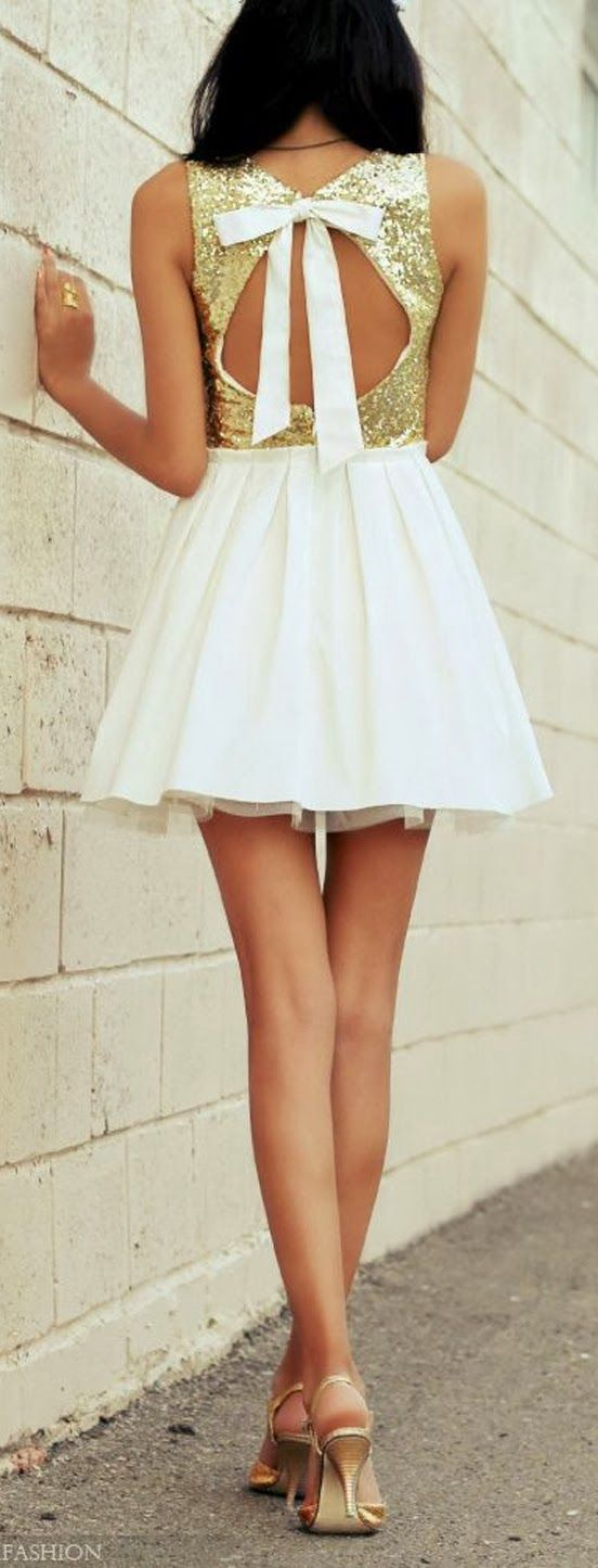 Flowy mini skirt and white bow top...add a purple grad gown and this just might be the outfit I walk in :)