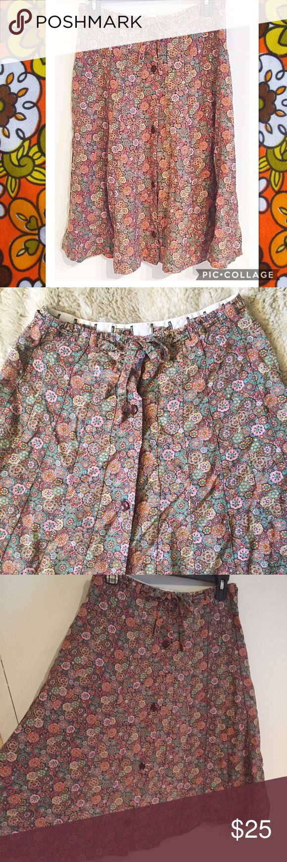 "Vintage 60s/70s Floral Button Up Skirt Vintage 60s/70s Floral Button Up skirt with drawstring waist. Looks like something Mila Kunis would have worn in that 70s show! No brand or size tags but measures 13.5"" flat at waist, and 25"" long.  #vintage #mod #floral #60s #70s #that70sshow #skirt #buttonup #drawstring #hippie #flowerchild #punkydoodle  No modeling Smoke free home I do discount bundles Vintage Skirts"