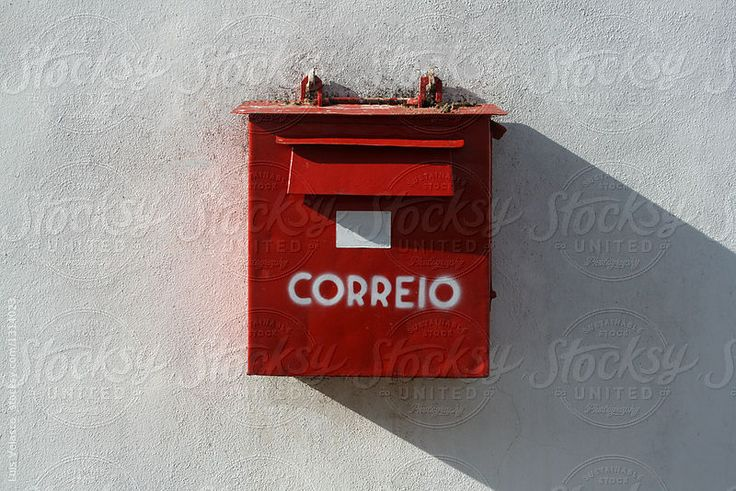 Red mailbox on a white facade in Portugal by Luis Velasco for Stocksy United