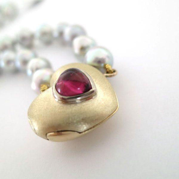 TWO HEARTS LOCKET 9ct yellow gold locket set with heart shaped pink tourmaline cabouchon on grey japanese pearls
