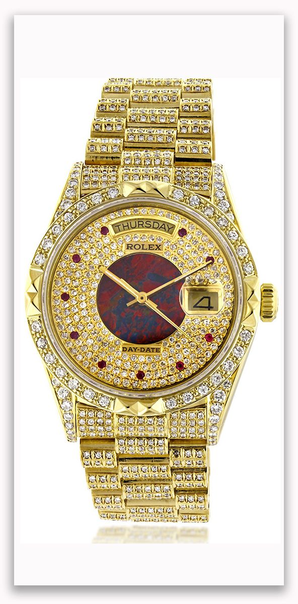 This lavish Mens Rolex Oyster Perpetual Day-Date Custom Diamond Watch is made of solid 18K yellow gold and showcases 14 carats of custom after market set diamonds.