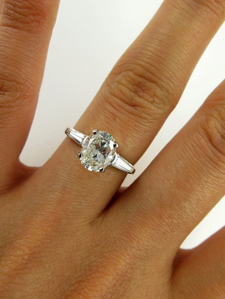 Baguette oval cut diamonds and engagement rings on pinterest
